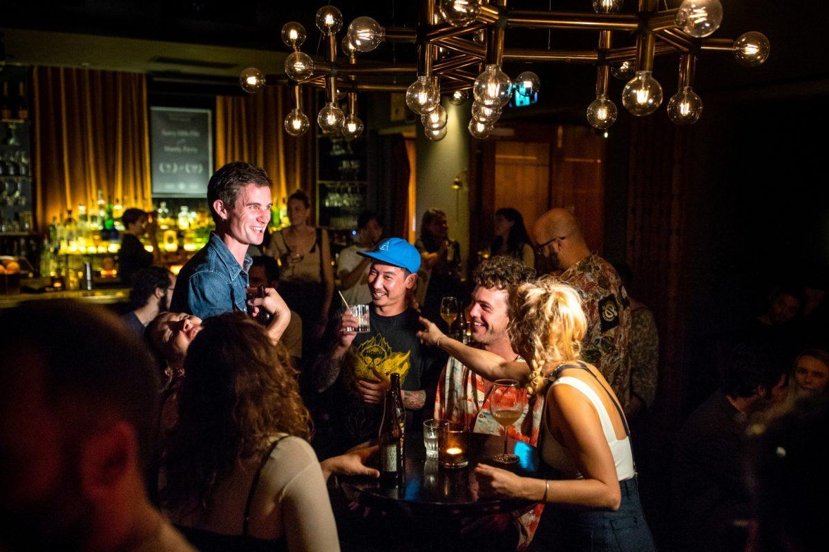 A tour group exploring the bar scene